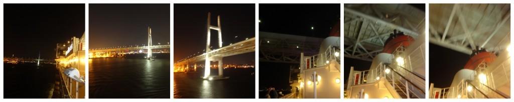 Queen Elizabeth just clears under the Yokohama Bay Bridge