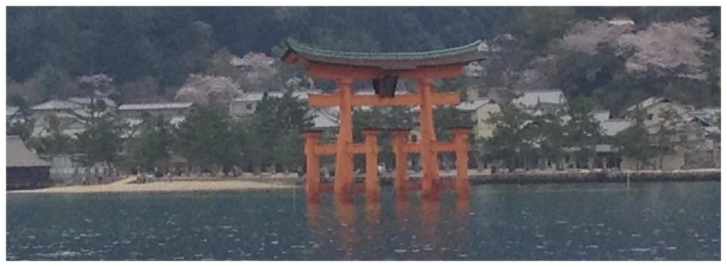 Torii gate from ferry with Miyajima behind