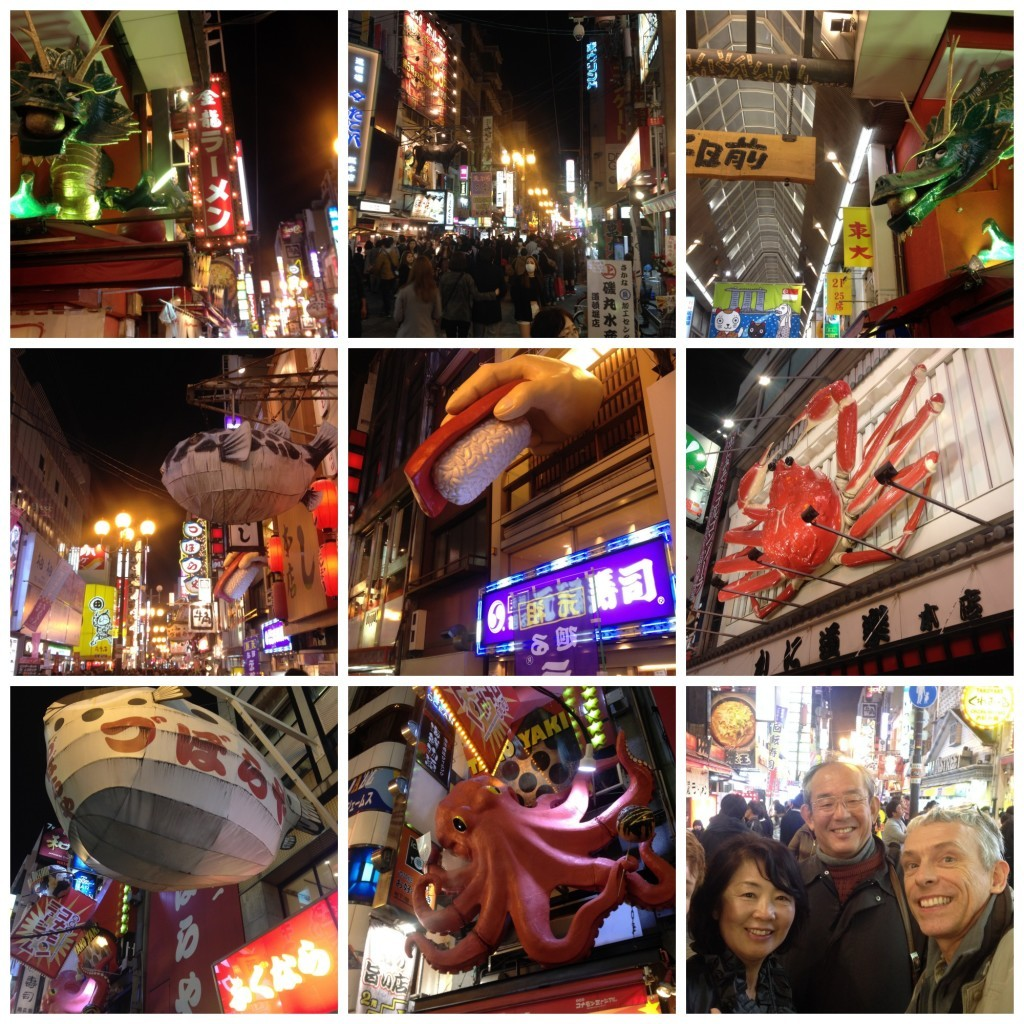 Restaurants in downtown Osaka with huge symbols above the enterance