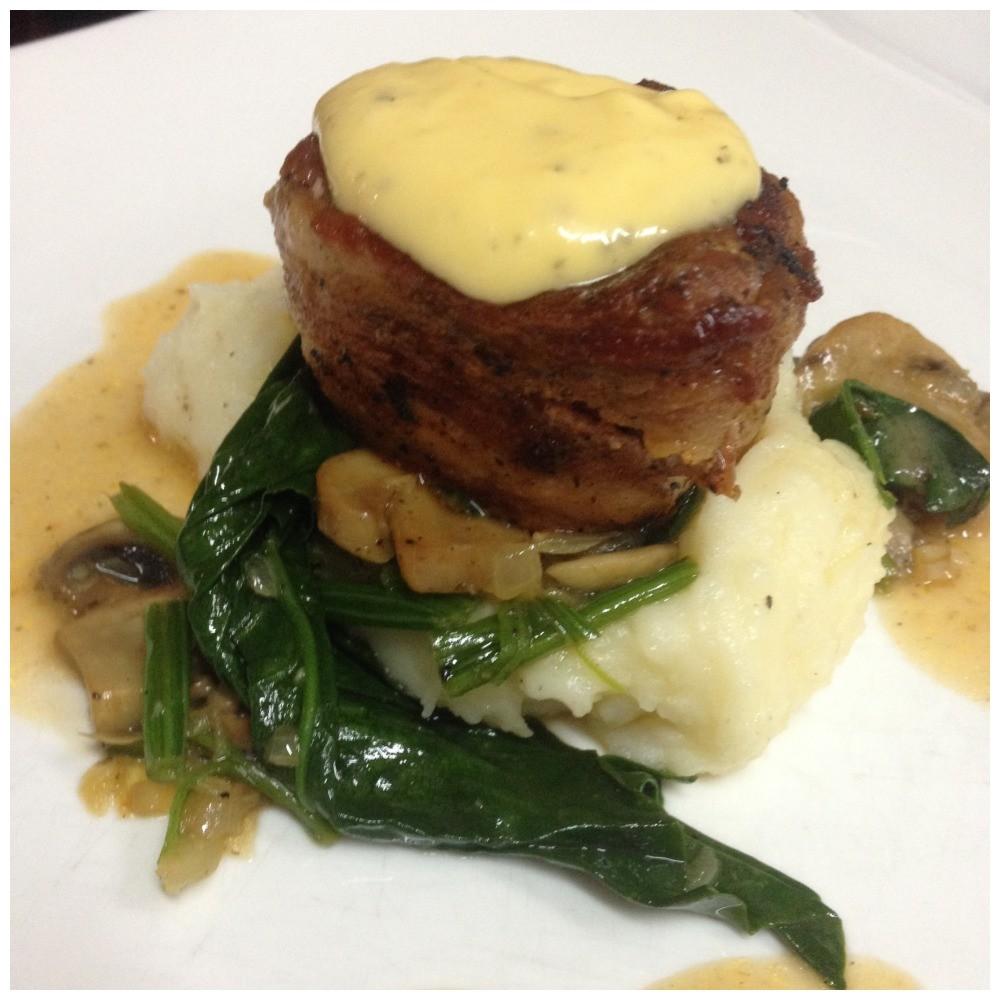 "Fourth course ""Pork tenderloin with bacon on mash mushrooms spinach with sauce bearnaise"""