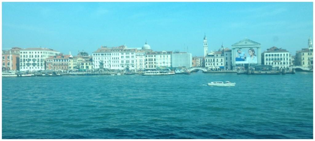 cruising along the Guidecca Canal towards the city's main cruise terminal
