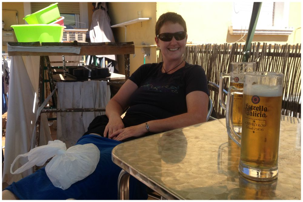 Enjoying a beer while resting the knee with some ice