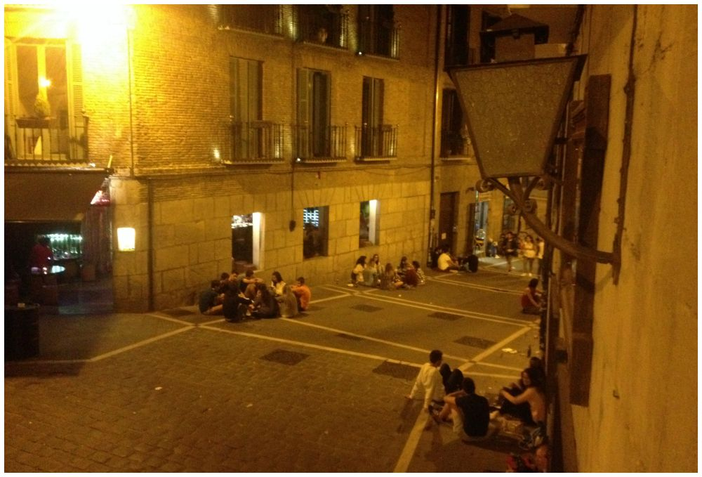 Night life of the young outside our hostel albergue in Pamplona