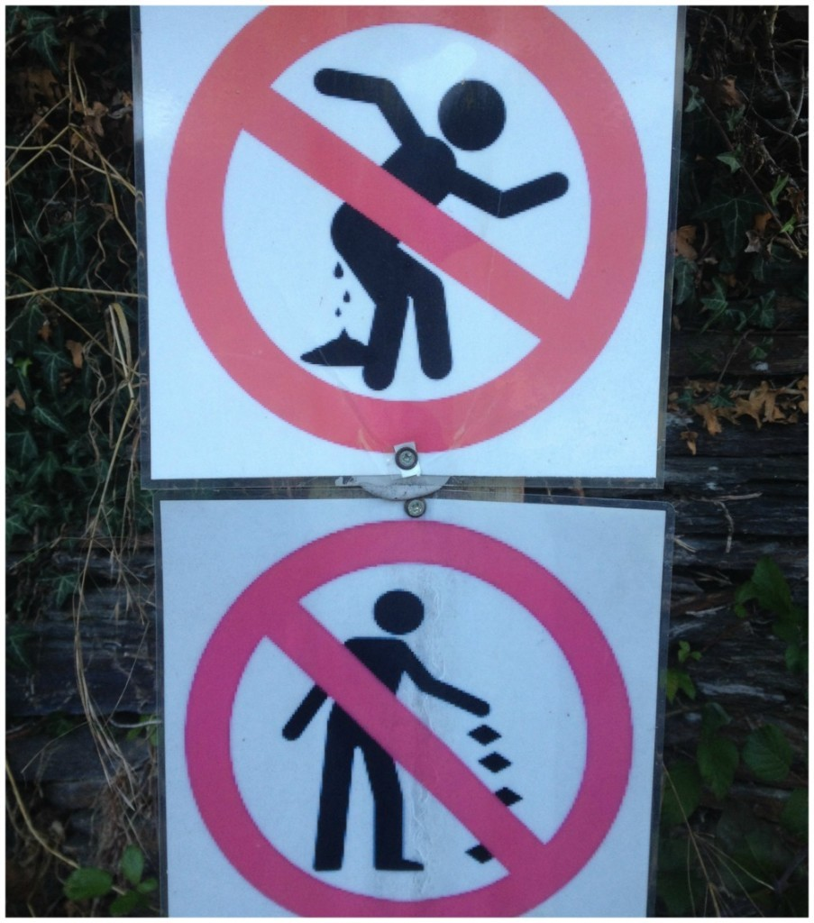Classic Camino signs - no littering and no shitting in the village of Lastires between Triacastela & Samos
