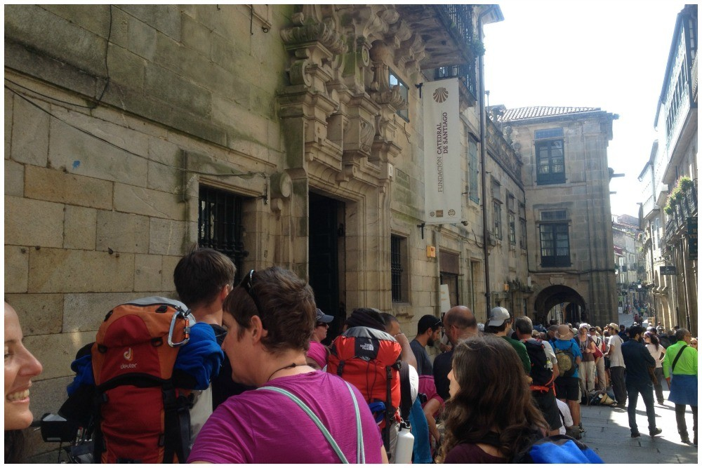 Waiting in line for our Compostela before jumping the queue as a group of four