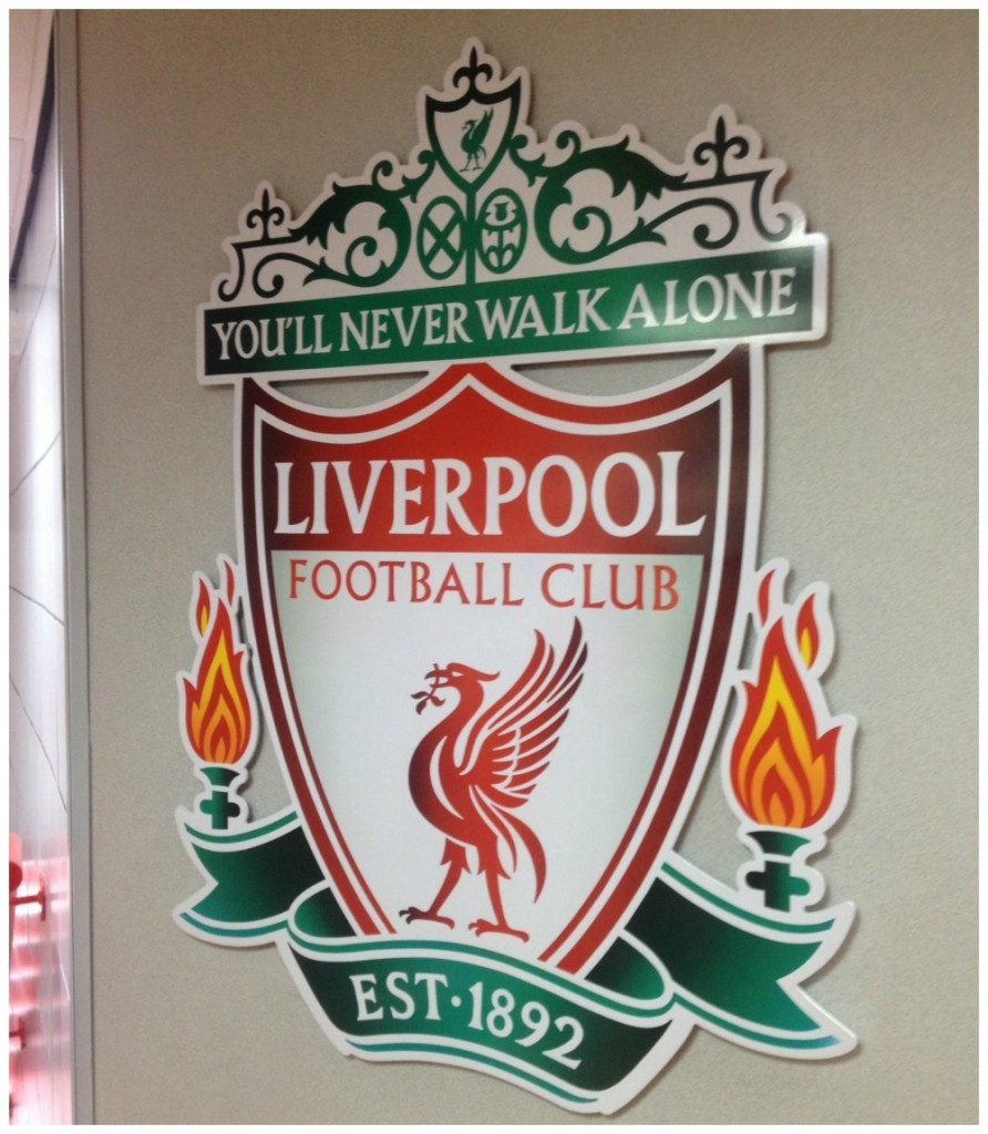 LFC badge on the wall at Anfield