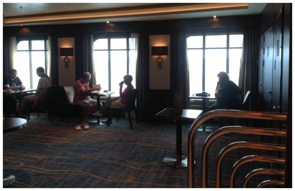 Norwegian Escape Atrium Cafe seating area