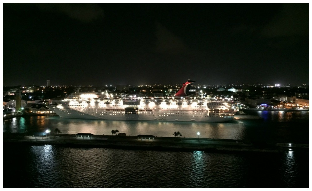 Carnival ship lit up at night as we leave Nassau