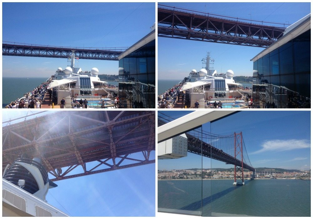 Celebrity Eclipse, aproaching, and passing under the bridge in Lisbon