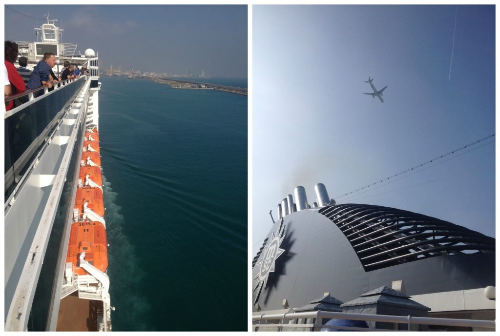 Approaching Barcelona port with planes passing above