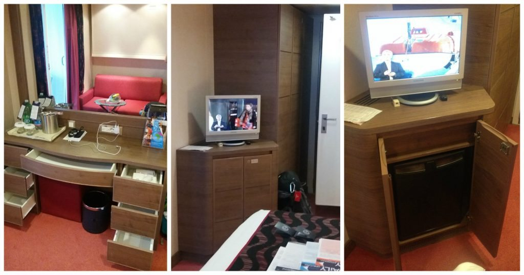 Drawer space and mini bar fridge with TV in balcony cabin 12116 on MSC Poesia