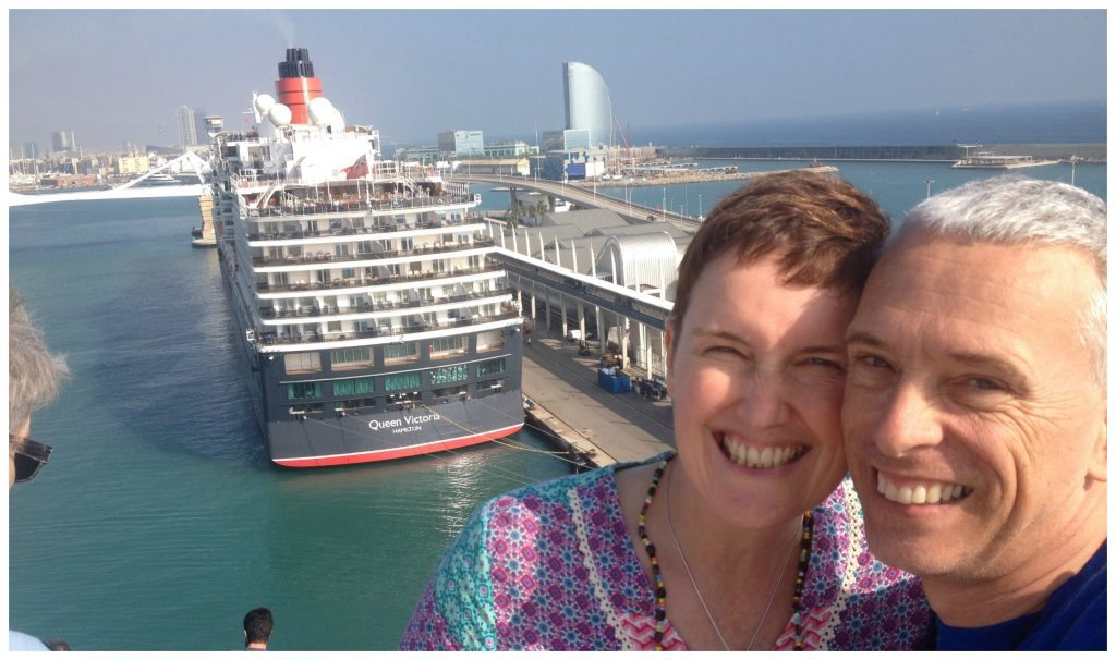 MSC Poesia docking behind Queen Victoria