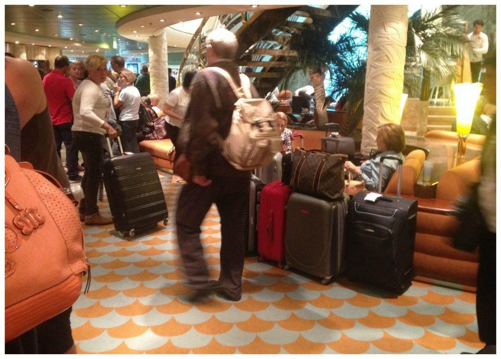 Passengers disembarking in Barcelona gathering