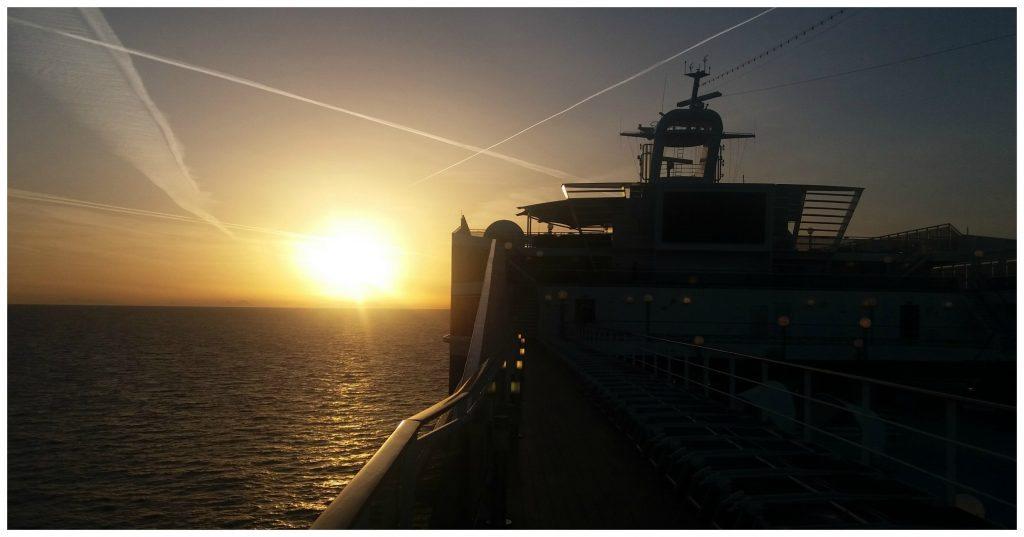 Sunrise at sea heading towards Naples