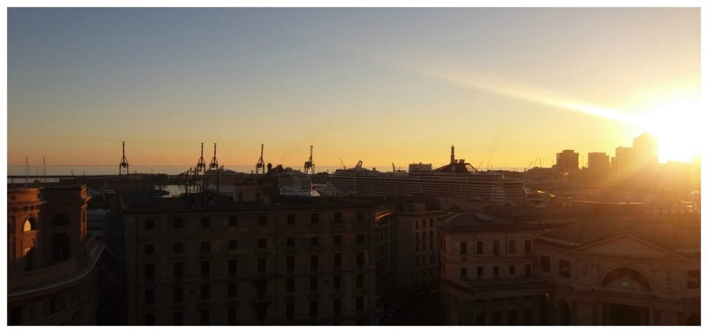 Sunset over the port of Genoa